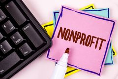 Text sign showing Nonprofit. Conceptual photo Activities that do not generate revenues to the executor written on Pink Sticky Note. Text sign showing Nonprofit Stock Photo