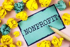 Text sign showing Nonprofit. Conceptual photo Activities that do not generate revenues to the executor written on Sticky Note pape. Text sign showing Nonprofit Stock Photo