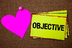 Text sign showing Objective. Conceptual photo Goal planned to be achieved Desired target Company mission Border sticky remember ca. Rds love heart pinned dark royalty free stock image