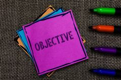 Text sign showing Objective. Conceptual photo Goal planned to be achieved Desired target Company mission Multiple colour sticky re. Member cards pen script royalty free stock images