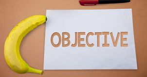 Text sign showing Objective. Conceptual photo Goal planned to be achieved Desired target Company mission Small paper drawing lines. Office work refreshment royalty free stock photo