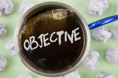 Text sign showing Objective. Conceptual photo Goal planned to be achieved Desired target Company mission written on Black Tea in C. Text sign showing Objective royalty free stock photos
