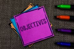 Text sign showing Objectives. Conceptual photo Goals planned to be achieved Desired targets Company missions Multiple colour stick. Y remember cards pen script stock photo