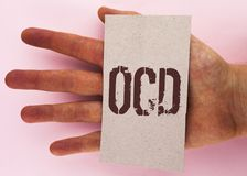 Text sign showing Ocd. Conceptual photo Obsessive Compulsive Disorder Psychological Illness Medical Condition written on Cardboard. Text sign showing Ocd Royalty Free Stock Photo