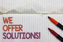Text sign showing We Offer Solutions. Conceptual photo Offering help assistance Experts advice strategies ideas White torn page wr. Itten some letters beside royalty free stock image