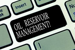 Text sign showing Oil Reservoir Management. Conceptual photo analysisaging the recovery of natural gas from rock. Keyboard key Intention to create computer stock photos