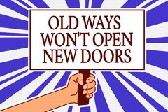 Free Text Sign Showing Old Ways Won T Not Open New Doors. Conceptual Photo Be Different And Unique To Achieve Goals Man Hand Holding Po Stock Photo - 121608910