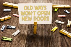 Text sign showing Old Ways Won t not Open New Doors. Conceptual photo be different and unique to Achieve goals Clothespin holding. White paper note several stock images