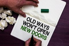 Text sign showing Old Ways Won t not Open New Doors. Conceptual photo be different and unique to Achieve goals Man holding marker. Notebook page crumpled papers stock photos