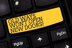 Text sign showing Old Ways Won T Open New Doors. Conceptual photo Change way you do things to accomplish goals Keyboard. Key Intention to create computer royalty free stock image
