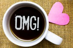 Text sign showing Omg Motivational Call. Conceptual photo Oh my good abbreviation Modern Astonishment expression Tea time coffee c Stock Photography