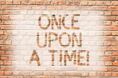 Text sign showing Once Upon A Time. Conceptual photo telling story Fairytale story Historical event Novel Brick Wall art royalty free stock photo