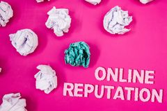 Text sign showing Online Reputation. Conceptual photo Reliability Ranking Review Evaluation Satisfaction Quality Text Words pink b. Ackground crumbled paper Royalty Free Stock Images