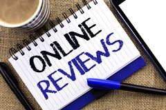 Text sign showing Online Reviews. Conceptual photo Internet Evaluations Customer Rating Opinions Satisfaction written on Notebook. Text sign showing Online Stock Image