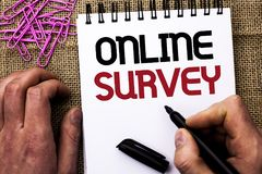 Text sign showing Online Survey. Conceptual photo Digital Media Poll Customer Feedback Opinions Questionnaire written by Man Holdi. Ng Marker Notebook Book the Royalty Free Stock Photo