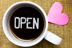Text sign showing Open. Conceptual photo Allow things to pass through or for immediate use Contrary of closed Tea time coffee cup. Office typing work jute rough royalty free stock photography