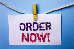 Text sign showing Order Now. Conceptual photo Buy Purchase Order Deal Sale Promotion Shop Product Register written on White Note P. Text sign showing Order Now Royalty Free Stock Image