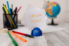 Text sign showing Order Now. Conceptual photo confirmed request by one party to another to buy sell Stationary plus pens. Text sign showing Order Now. Business royalty free stock photos