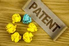 Text sign showing Patent. Conceptual photo License that gives rights for using selling making a product written on Folded Cardboar. Text sign showing Patent stock photo