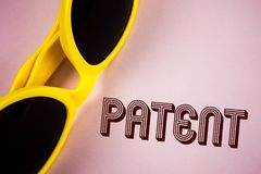 Text sign showing Patent. Conceptual photo License that gives rights for using selling making a product written on Plain Pink back. Text sign showing Patent stock photography