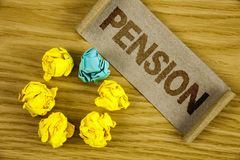 Text sign showing Pension. Conceptual photo Income seniors earn after retirement Saves for elderly years written on Folded Cardboa. Text sign showing Pension Stock Photo
