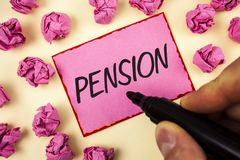 Text sign showing Pension. Conceptual photo Income seniors earn after retirement Saves for elderly years written by Man on Sticky. Text sign showing Pension Stock Photo