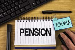 Text sign showing Pension. Conceptual photo Income seniors earn after retirement Saves for elderly years written on Noteoad on woo. Text sign showing Pension Royalty Free Stock Photo