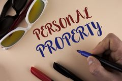 Text sign showing Personal Property. Conceptual photo Belongings possessions assets private individual owner written by Man on pla. Text sign showing Personal Stock Image