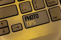 Text sign showing Photo Tips. Conceptual photos Suggestions to take good pictures Advices for great photosgraphyKeyboard brown key. Text sign showing Photo Tips stock photography
