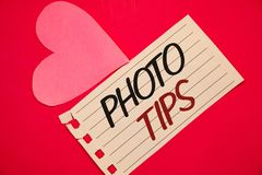 Text sign showing Photo Tips. Conceptual photos Suggestions to take good pictures Advices for great photosgraphyNotebook page red. Text sign showing Photo Tips stock photography