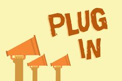 Text sign showing Plug In. Conceptual photo putting device into electricity to turn it on Power it Connecting Hands holding megaph. Ones loudspeakers important Stock Image