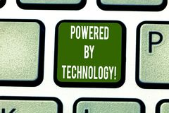 Text sign showing Powered By Technology. Conceptual photo Breakthrough led to the broad commercialization Keyboard key. Intention to create computer message stock photos