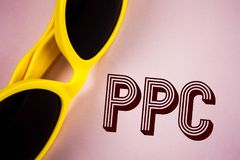 Text sign showing Ppc. Conceptual photo Pay Per Click Advertising Strategies Direct Traffic to Websites written on Plain Pink back. Text sign showing Ppc royalty free stock photography