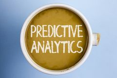 Text sign showing Predictive Analytics. Conceptual photo Method to forecast Performance Statistical Analysis written on Coffee in. Text sign showing Predictive Stock Photo