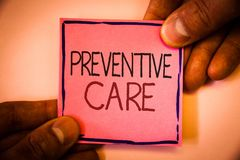 Text sign showing Preventive Care. Conceptual photo Health Prevention Diagnosis Tests Medical Consultation Man hold holding pink p. Aper ideas black red letters Stock Photo