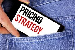 Text sign showing Pricing Strategy. Conceptual photo Marketing sales strategies profit promotion campaign written on Mobile phone. Text sign showing Pricing Stock Photo