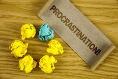 Text sign showing Procrastination Motivational Call. Conceptual photo Delay or Postpone something boring written on Folded Cardboa. Text sign showing stock images