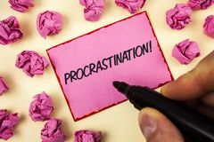Text sign showing Procrastination Motivational Call. Conceptual photo Delay or Postpone something boring written by Man on Sticky. Text sign showing stock photography