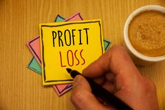 Text sign showing Profit Loss. Conceptual photos Financial year end account contains total revenues and expensesMan creating yello. Text sign showing Profit Loss stock photography