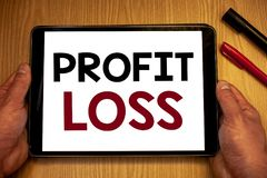 Text sign showing Profit Loss. Conceptual photos Financial year end account contains total revenues and expensesMan hold holding t. Text sign showing Profit Loss royalty free stock image