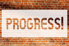 Text sign showing Progress. Conceptual photo Development Growth Process of improvement to achieve a goal Brick Wall art like. Graffiti motivational call written stock photography