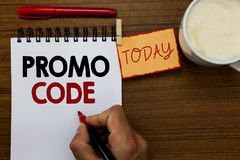 Text sign showing Promo Code. Conceptual photo digital numbers that give you good discount on certain product Man holding marker n. Otebook clothespin reminder royalty free stock photo