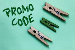 Text sign showing Promo Code. Conceptual photo digital numbers that give you good discount on certain product Three brown green vi. Ntage clothespins clear royalty free stock images