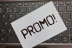 Text sign showing Promo Motivational Call. Conceptual photo Piece of advertising Discount Special Offer Sale Black laptop keyboard. Art paper nice computer Royalty Free Stock Photos