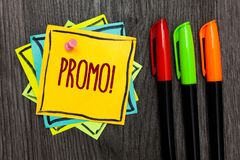 Text sign showing Promo Motivational Call. Conceptual photo Piece of advertising Discount Special Offer Sale Three marker pens fou. R small art papers important royalty free stock photography