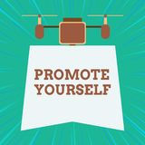Text sign showing Promote Yourself. Conceptual photo market and introduce to others Improvement Encourage Drone holding. Text sign showing Promote Yourself stock photo