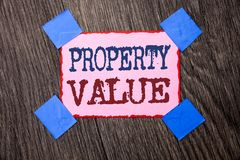 Text sign showing Property Value. Conceptual photo Estimate of Worth Real Estate Residential Valuation written on Pink Sticky Note. Text sign showing Property royalty free stock photography