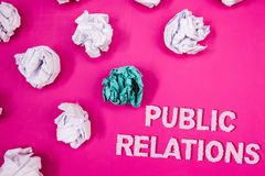 Text sign showing Public Relations. Conceptual photo Communication Media People Information Publicity Social Text Words pink backg. Round crumbled paper notes stock image