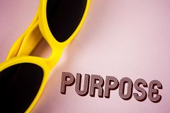 Text sign showing Purpose. Conceptual photo Reason for doing something Desired Goal Target Planned Achievement written on Plain Pi. Text sign showing Purpose Royalty Free Stock Photography