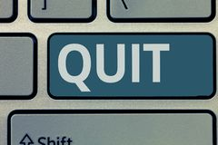 Text sign showing Quit. Conceptual photo Resigning from a job Discontinue the action Stop the activity.  stock image